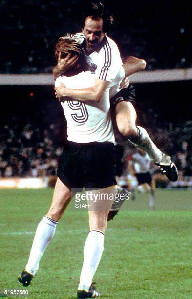 West German defender Ulrich Stielike jumps in the arms of forward Horst Hrubesch after he scored the winning penalty kick in extra time 08 July 1982...