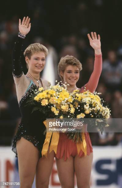 West German figure skaters Claudia Leistner and Patricia Neske pictured together on the medal podium after winning the gold and bronze medals...