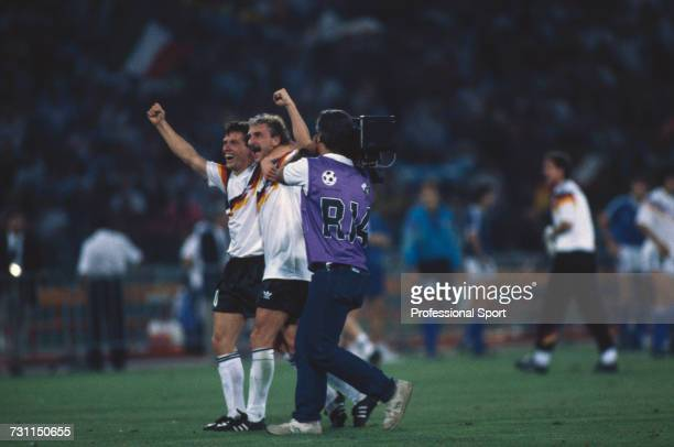 West German footballers Lothar Matthaus on left and Rudi Voller celebrate after West Germany beat Argentina 10 to win the 1990 FIFA World Cup Final...