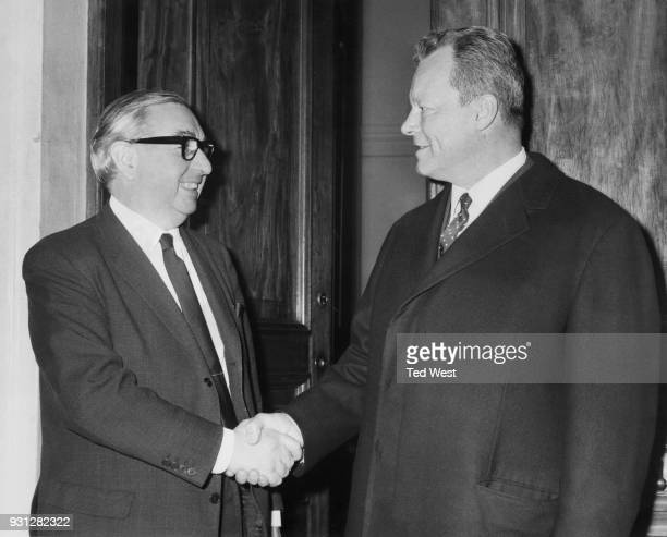 West German Foreign Minister Willy Brandt is greeted by British Foreign Minister George Brown after his arrival in London for two days of talks 12th...