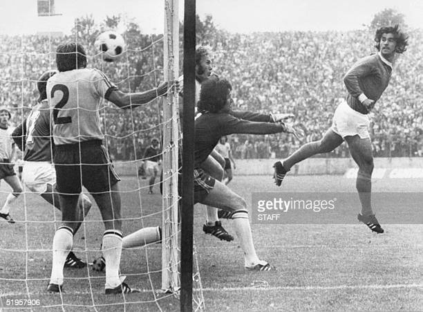 West German forward Gerd Mueller scores on a header past Australian goalkeeper Jack Reilly and defender Doug Utjesenovic during the World Cup first...