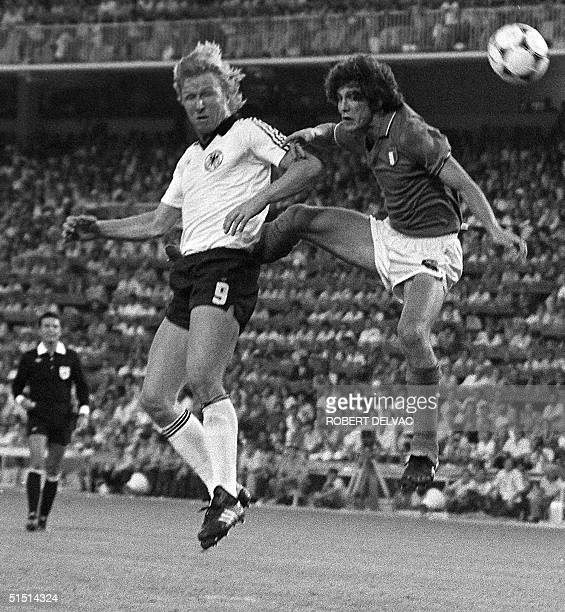 West German forward Horst Hrubesch heads the ball in front of Italian defender Fulvio Collovati during the World Cup final between West Germany and...