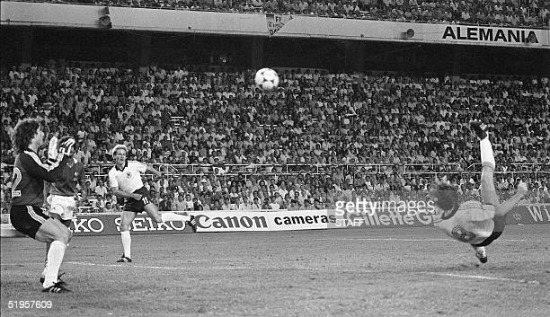 West German forward Klaus Fischer ties the score at 3 on a reverse bicycle kick past French goalkeeper JeanLuc Ettori during the extra time period of...
