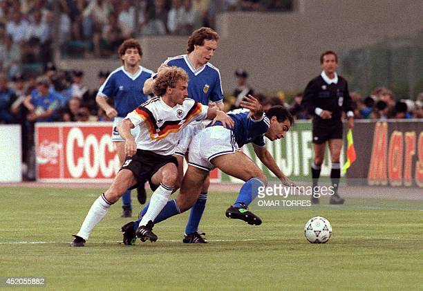 West German forward Rudi Voeller fights for the ball with Argentinian Jose Serrizuela during the soccer World Cup final Argentina vs West Germany 08...