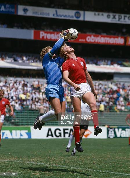 West German goalkeeper Harald Schumacher catches the ball above England's Mark Wright during the International friendly atch at the Aztec Stadium in...