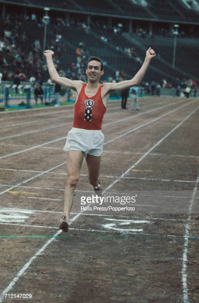 West German long distance runner Manfred Letzerich pictured in action leading to win the Men's 10000 metres race at an Olympic trials athletics...