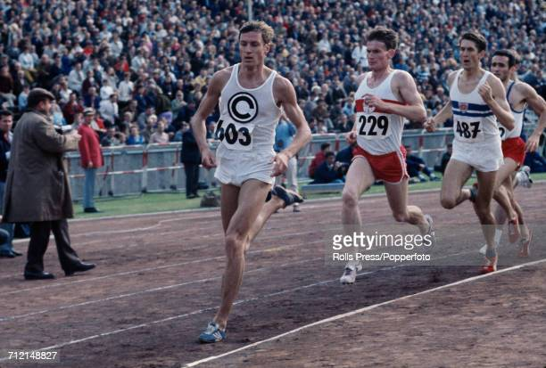 West German middle distance runner Bodo Tummler pictured in action leading to win the 1500 metres race at an Olympic trials athletics meeting in...