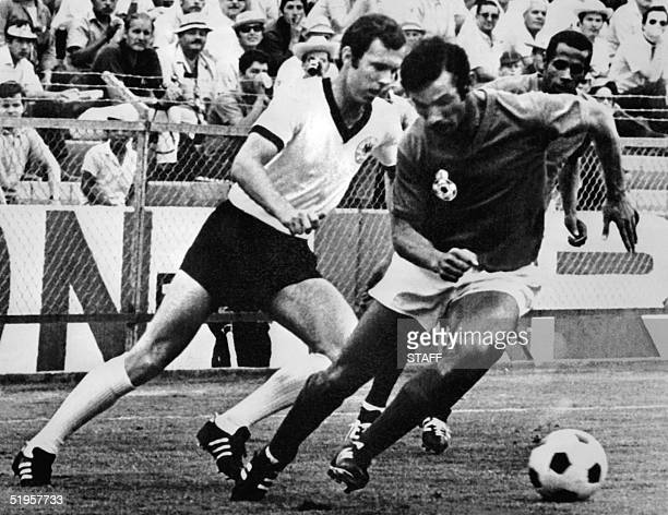 West German midfielder Franz Beckenbauer fights for the ball with Moroccan Benkhrif Boujemaa as Mohammed El Filali looks on during the World Cup...
