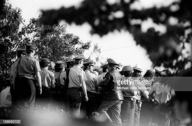 West German Police gather near the quarters of the Israili Olympic team where members of the Black September Organization are holding 9 surviving...