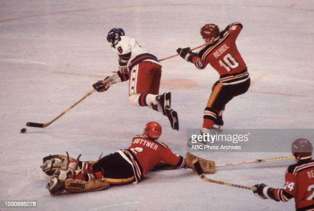 West German team vs United States team competing in the Men's ice hockey tournament at the 1980 Winter Olympics / XIII Olympic Winter Games Olympic...