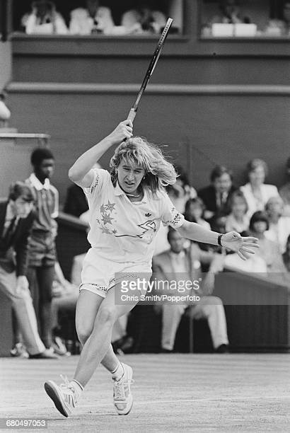 West German tennis player Steffi Graf pictured in action against Martina Navratilova in the final of the Women's Singles tournament at the Wimbledon...