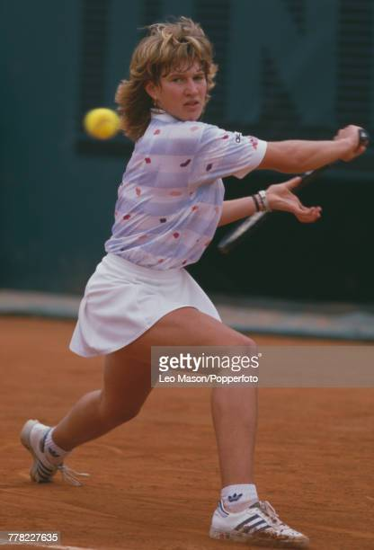 West German tennis player Steffi Graf pictured in action competing to progress to reach the final and win the Women's Singles tournament to become...