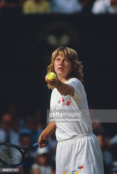 West German tennis player Steffi Graf pictured in action during progress to reach the final of the Ladies' Singles tournament at the Wimbledon Lawn...