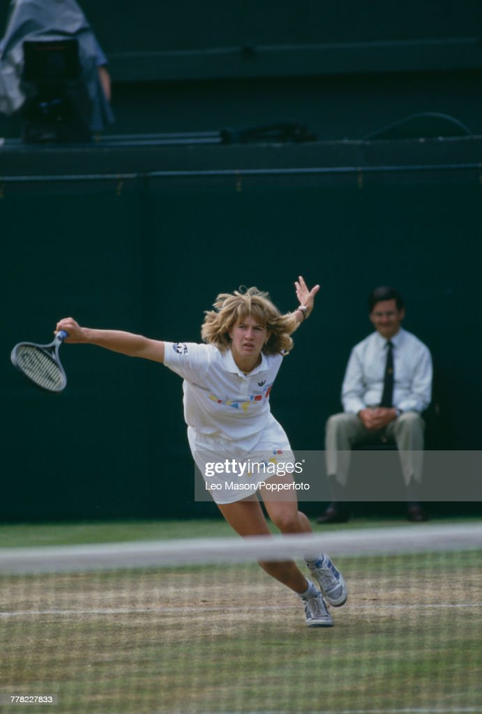 West German tennis player Steffi Graf pictured in action during progress to reach the final of the Ladies' Singles tournament at the Wimbledon Lawn Tennis Championships at the All England Lawn Tennis Club in Wimbledon, London in July 1987. Graf would go on to lose to Martina Navratilova in the final, 7-5, 6-3 on 4th July.