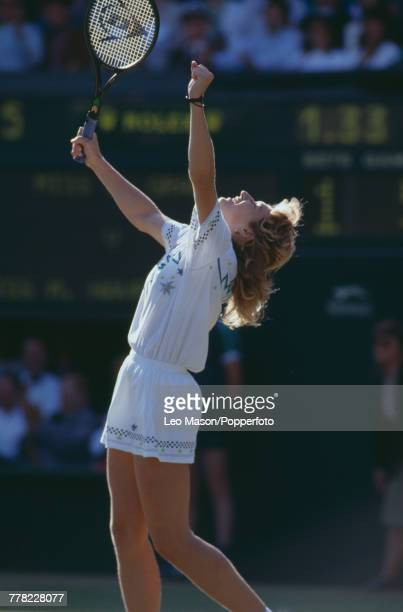 West German tennis player Steffi Graf raises her arms in the air during the final of the Ladies' Singles tournament against Martina Navratilova at...