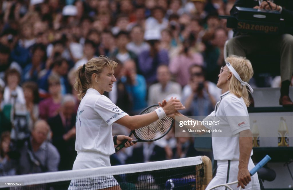West German tennis player Steffi Graf (left) shakes hands with American tennis player Martina Navratilova after winning the final of the Ladies' Singles tournament 6-2, 6-7, 6-1 to become champion at the Wimbledon Lawn Tennis Championships at the All England Lawn Tennis Club in Wimbledon, London on 8th July 1989.
