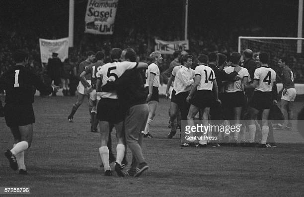 West German trainers and officials invade the pitch to celebrate after their World Cup semi final victory against the Soviet Union team at Goodison...