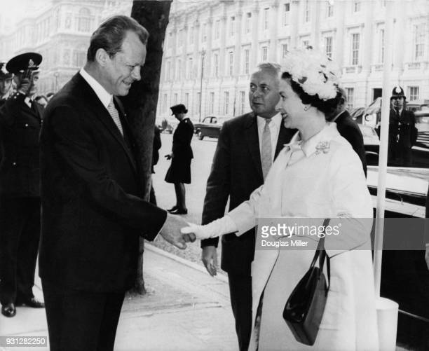 West German Vice Chancellor Willy Brandt greets Queen Elizabeth II as she arrives at the Banqueting Hall in Whitehall London for the 20th anniversary...