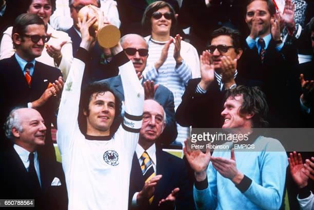 West Germany captain Franz Beckenbauer lifts the World Cup as goalkeeper Sepp Maier applauds