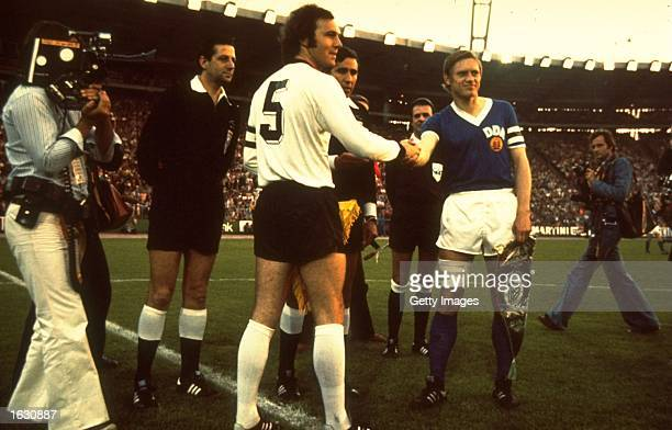 West Germany Captain Franz Beckenbauer shakes hands with the East Germany Captain before a match Mandatory Credit Allsport UK /Allsport