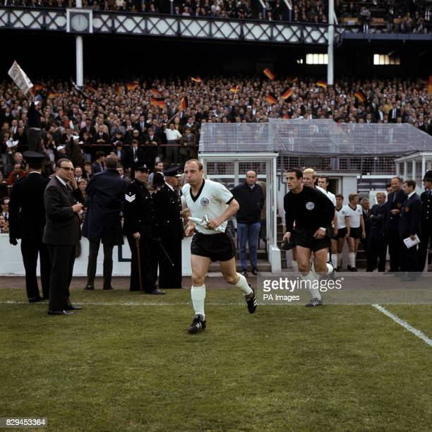 West Germany captain Uwe Seeler leads his team out followed by goalkeeper Hans Tilkowski and KarlHeinz Schnellinger