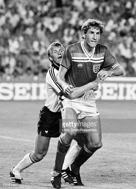 West Germany defender Bernd Foerster holds Terry Butcher of England as they wait for a cornerkick during the FIFA World Cup second phase match...