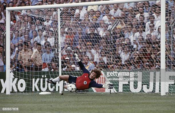 West Germany goalkeeper Harald Schumacher saves a penalty during the FIFA World Cup Final between Italy and West Germany at the Santiago Bernabeu...