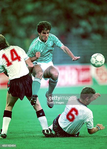 West Germany player KarlHeinz Riedle is tackled by Mark Wright and Terry Butcher during the 1990 World cup semi final between England and West...