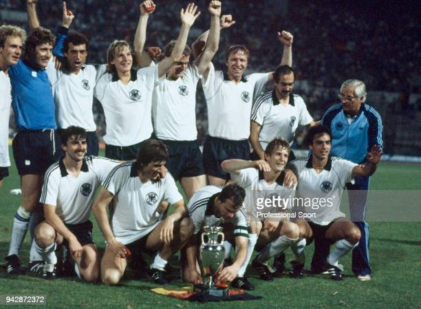 West Germany players and staff celebrate with the trophy after the UEFA Euro 1980 Final between Belgium and West Germany at the Stadio Olympico on...