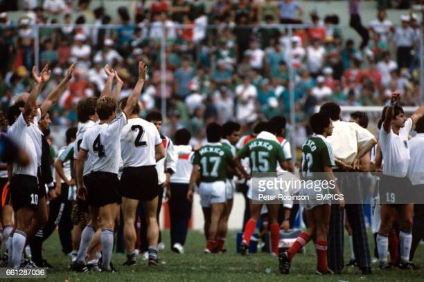 West Germany players celebrate their penalty shootout victory to the disappointment of the Mexico players