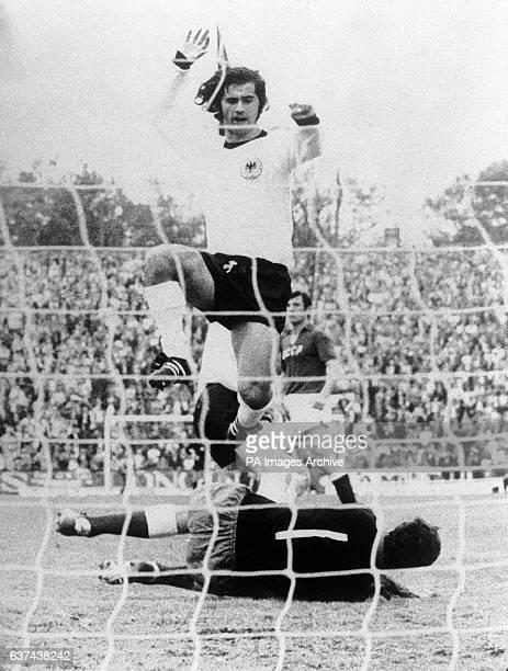 West Germany's Gerd Muller leaps over USSR goalkeeper Yevgen Rudakov after touching home his team's third goal