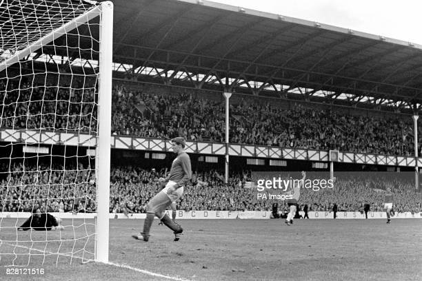 West Germany's Helmut Haller celebrates after scoring the opening goal past USSR goalkeeper Lev Yashin