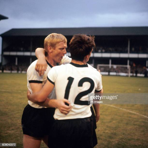 West Germany's KarlHeinz Schnellinger and Wolfgang Overath celebrate victory