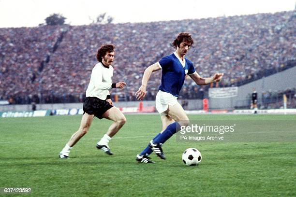 West Germany's Paul Breitner shadows East Germany's Harald Irmscher