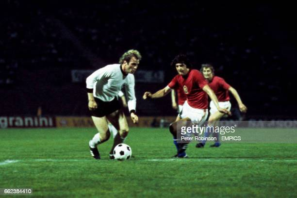 West Germany's Uli Hoeness takes on the Czechoslovakia's Anton Ondrus
