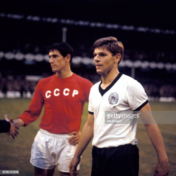West Germany's Wolfgang Weber looks quietly satisfied with reaching the World Cup Final as USSR's Valeri Voronin dejectedly shakes hands