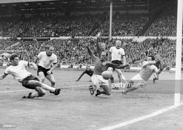 West Germany's Wolfgang Weber pokes the ball past England's diving goalkeeper Gordon Banks for an equaliser in the last minute of normal time in the...
