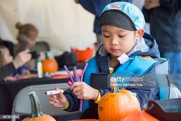 Children participating in the Halloween craft activity at the Fest Toronto West Halloween Fest at BloorWest Village is a fundraising event in support...
