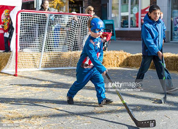 Children playing hockey at the Fest wearing different costumes Toronto West Halloween Fest at BloorWest Village is a fundraising event in support of...