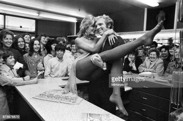 West Ham and England football star Bobby Moore with model Kate Howard in Oxford Street London to promote the new nude look Norlyn Niknax tights on...