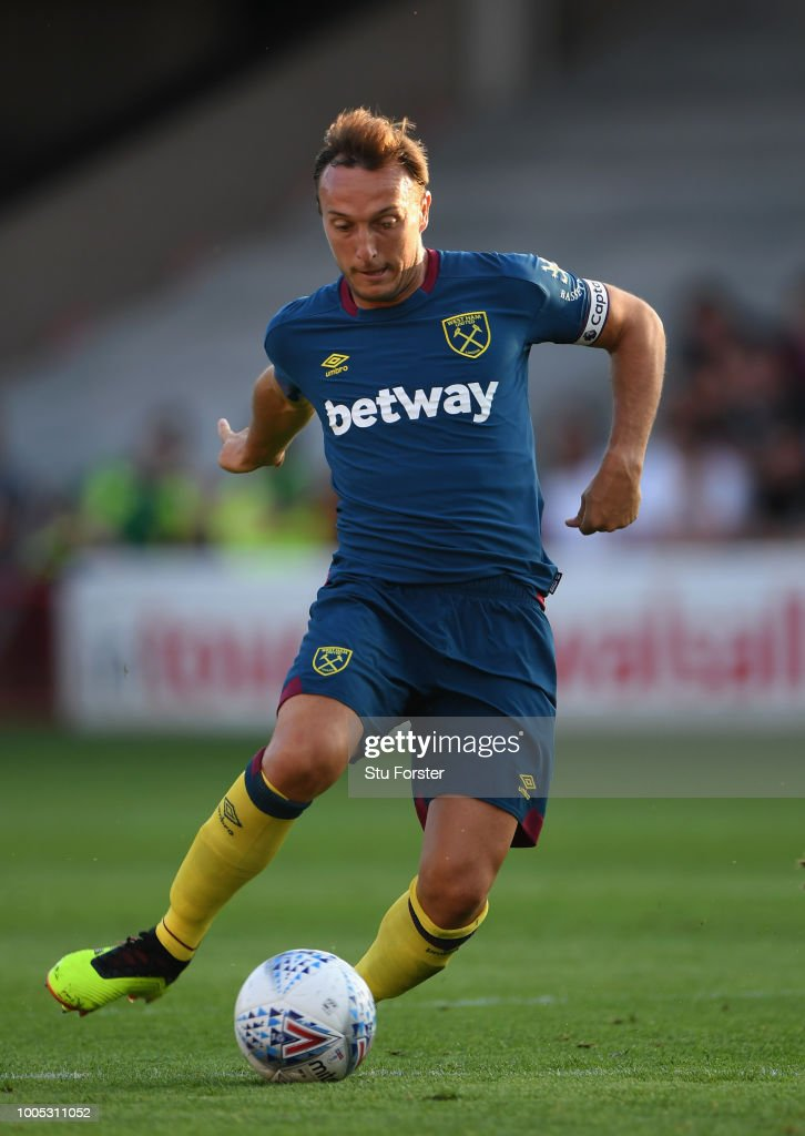 West Ham captain Mark Noble in action during a friendly match between Aston Villa and West Ham United at Banks' Stadium on July 25, 2018 in Walsall, England.