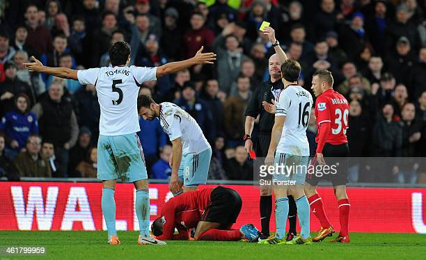 West Ham defender James Tomkins is shown a second yellow card by referee L Mason and sent off for a foul on Cardiff forward Fraizer Campbell during...