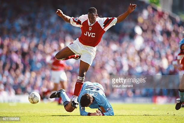 West Ham defender Tony Gale challenges Ian Wright of Arsenal during the FA Premiership match at Highbury on April 30 1994 in London England