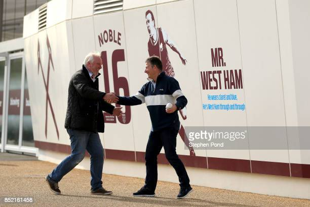 West Ham fans arrive at the stadium prior to the Premier League match between West Ham United and Tottenham Hotspur at London Stadium on September 23...