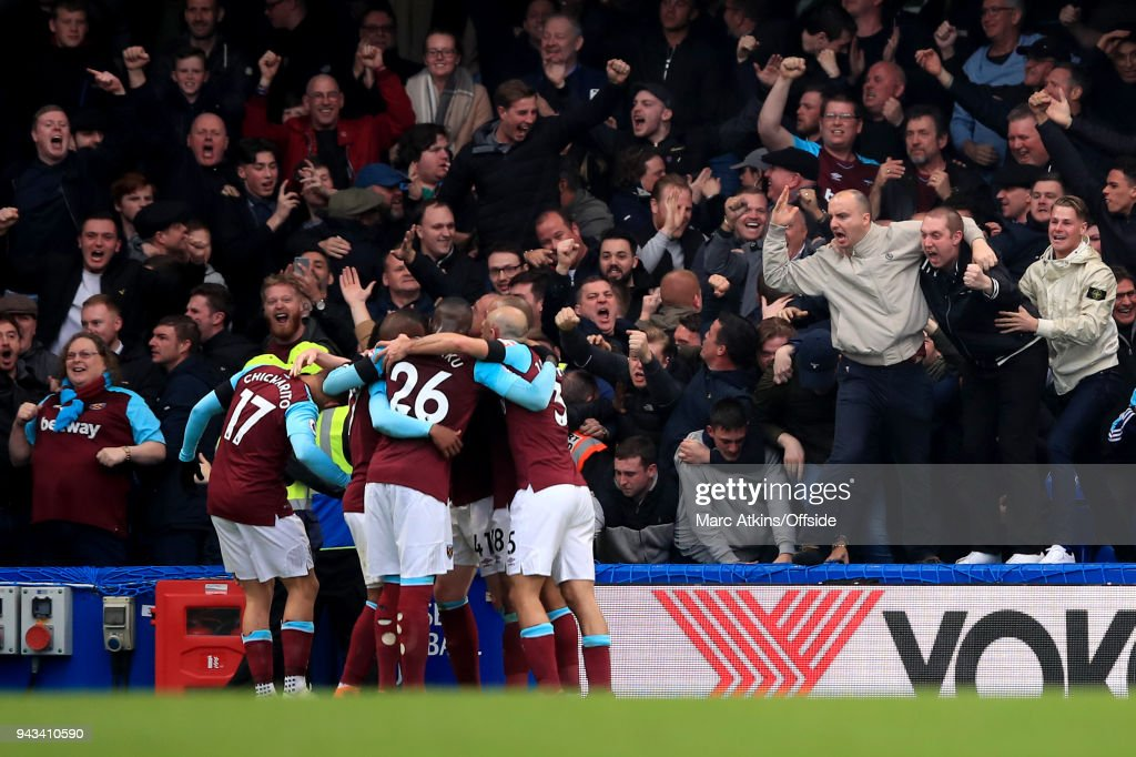 West Ham fans celebrate the equalising goal from Javier Hernandez during the Premier League match between Chelsea and West Ham United at Stamford Bridge on April 8, 2018 in London, England.