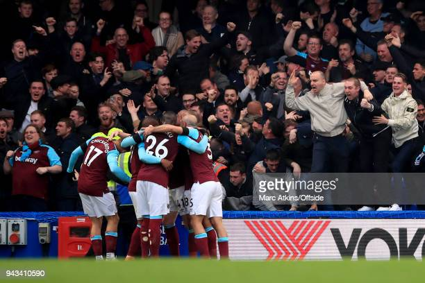 West Ham fans celebrate the equalising goal from Javier Hernandez during the Premier League match between Chelsea and West Ham United at Stamford...