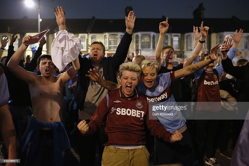 West Ham fans celebrate theior win over Manchester United outside the Boleyn Ground, the Home of West Ham United football club on May 10, 2016 in London, England. Tonights Premier League match against Manchester United is the last game at the Boleyn Ground, bringing to an end 112 years of the clubs history at the ground. The club will move into the Olympic Stadium next season, making way for developers and plans for 800 new homes where the stadium now stands.