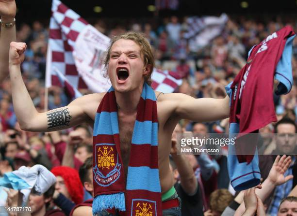 West Ham fans celebrate their team's victory after the npower Championship Playoff Final between West Ham United and Blackpool at Wembley Stadium on...