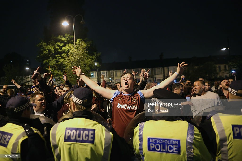 West Ham fans celebrate their win over Manchester United outside the Boleyn Ground, the Home of West Ham United football club on May 10, 2016 in London, England. Tonights Premier League match against Manchester United is the last game at the Boleyn Ground, bringing to an end 112 years of the clubs history at the ground. The club will move into the Olympic Stadium next season, making way for developers and plans for 800 new homes where the stadium now stands.