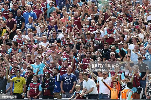 West Ham fans cheer as bubbles fill the air before the kick off of the pre-season friendly football match between West Ham United and Juventus at the...